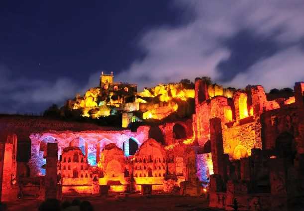 A Night View Of Golconda Fort With Colorful Lights